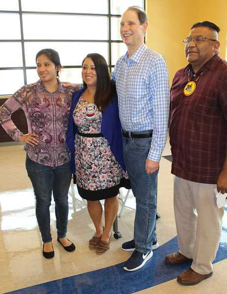 """HOLLY M. GILL - U.S. Sen. Ron Wyden, third from left, held a town hall in Warm Springs Aug. 10, 2017. From left, Karlen Yallup, Tribal Council member Carina Miller, and Council Chairman Eugene """"Austin"""" Greene, flank Wyden."""