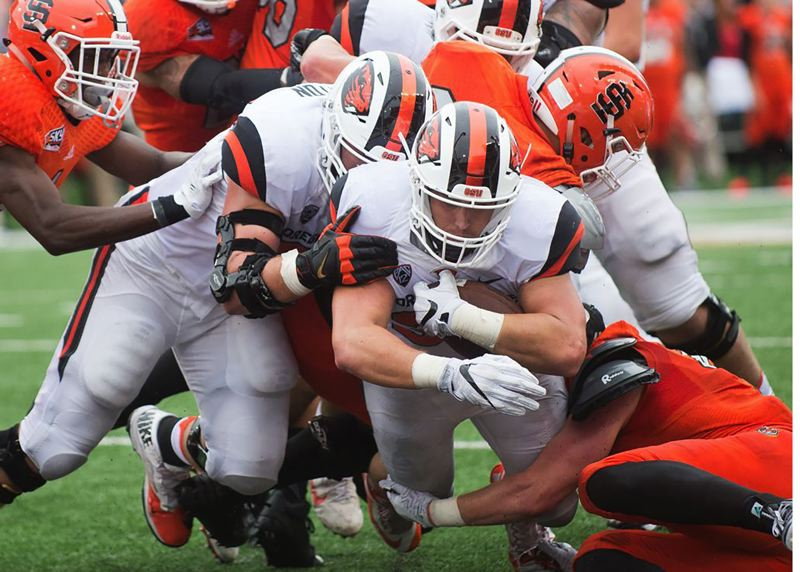PAMPLIN MEDIA GROUP - Sandy native and Central Catholic graduate Ryan Nall has decided to forgo his senior year at Oregon State and declare for the NFL Draft in April.