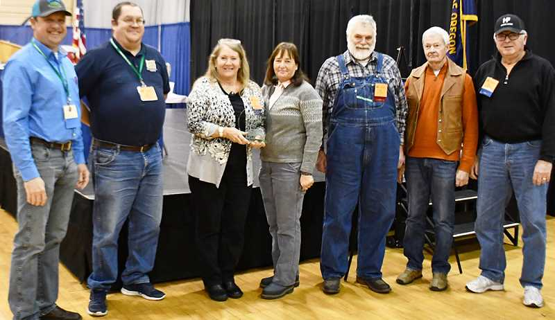 SUBMITTED PHOTO - Attending the meeting, from left are OFB Membership Committee Chairman Logan Kerns, and Jefferson County Farm Bureau members Ray Austin, President Sue Vanek, Mickey Killingsworth, Ed Chotard, Paul Clowers, and Gary Harris.