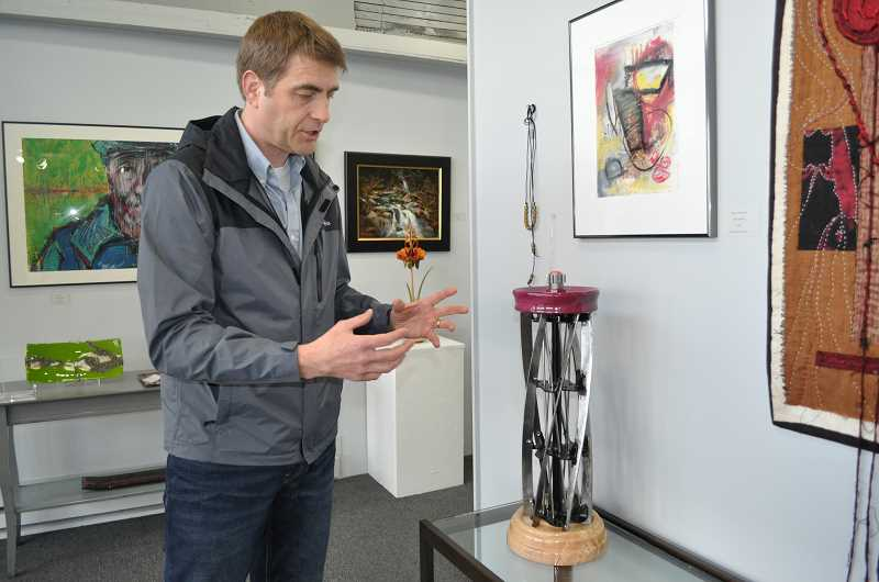 TIMES PHOTO: BLAIR STENVICK - 'I put those pieces of stainless steel in the center there, to go counter to the blades themselves,' Sam Hingston said about his piece. 'So a little bit of visual interest there, and in the end I went for a chess piece.'