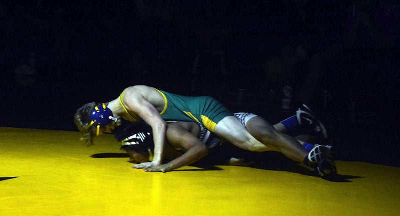 TIMES PHOTO: MATT SINGLEDECKER - Aloha 132-pound Colton Flemming was one of the Warriors to win his match against Century last week.