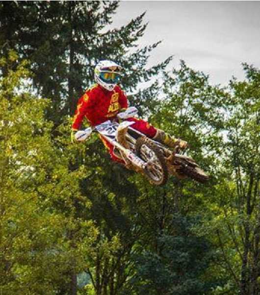 COURTESY PHOTO - Gales Creek's Rider Fisher flies high through the air over a jump during a race last season.
