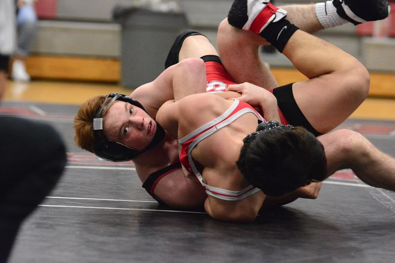 OUTLOOK PHOTO: DAVID BALL - David Douglas senior Kyle Beal works toward a second-period technical fall at 145 pounds.