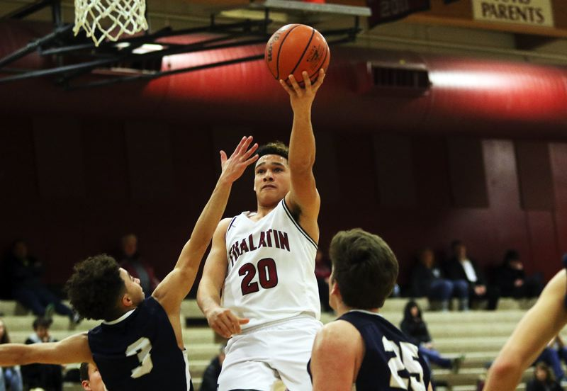 DAN BROOD - Tualatin High School sophomore John Miller goes up to the basket during the Wolves' league win over Canby on Tuesday.