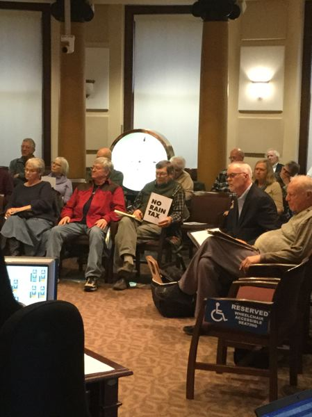 TRIBUNE PHOTO: STEVE LAW - Floating homeowners watch testimony against a proposed ordinance that will raise their monthly utility payments. Second from right is Ron Schmidt, who is a leader in the campaign against the ordinance.