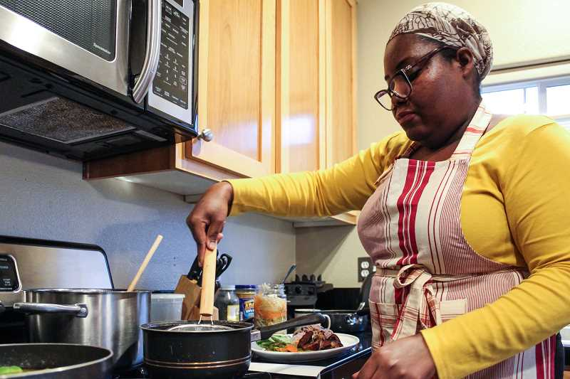 HILLSBORO TRIBUNE PHOTO: GEOFF PURSINGER - Elsy Dinvil, 46, grew up in Haiti cooking Caribbean meals with her mother. Dinvil has started a new pop-up restaurant featuring her favorite Haitian recipies, with dreams of one day opening up a restaurant in Hillsboro.