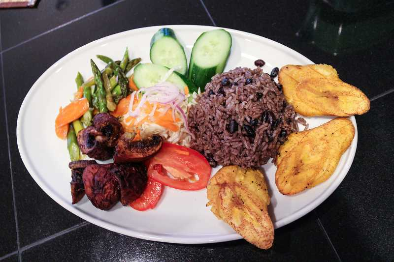HILLSBORO TRIBUNE PHOTO: GEOFF PURSINGER - Creole Creations monthly dinners include plenty of meat and veggies, as well as friend plantains, rice and beans. Hillsboro Tribune Photo: Geoff Pursinger