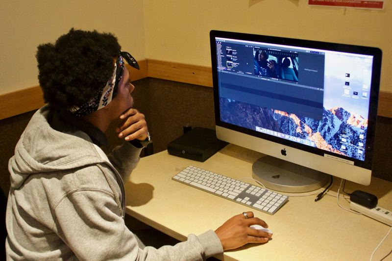 OUTLOOK PHOTO: CHRISTOPHER KEIZUR - Dajour Mckinley is able to use the editing rooms and equipment at MetroEast to work on his movie projects.