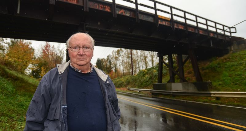 OUTLOOK FILE PHOTO - Fairview Mayor Ted Tosterud stands by a Union Pacific railroad overpass north of Interstate 84.
