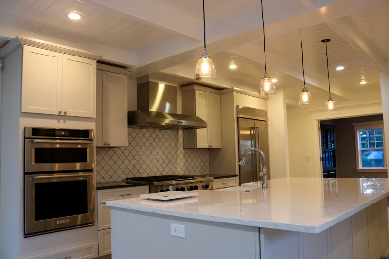 OUTLOOK PHOTO: ZANE SPARLING - A European-style kitchen suite includes high-end, stainless-steel appliances by KitchenAid.
