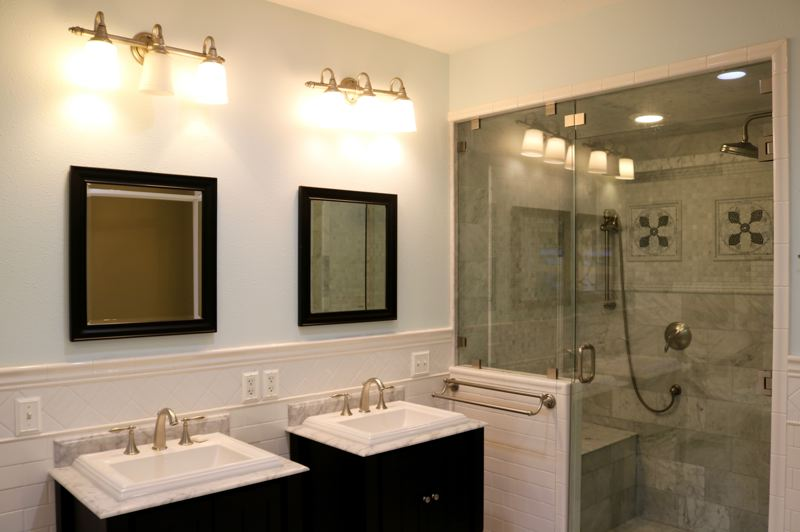 OUTLOOK PHOTO: ZANE SPARLING - Mosaic tile accents distinguish this massive walk-in shower with sitting ledge in the master bathroom.
