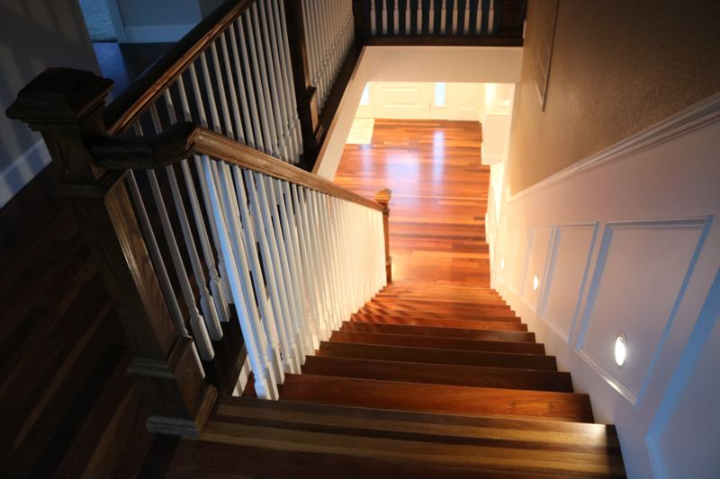 OUTLOOK PHOTO: ZANE SPARLING - The staircase is tastefully lit by recessed LED lights set close to the ground.