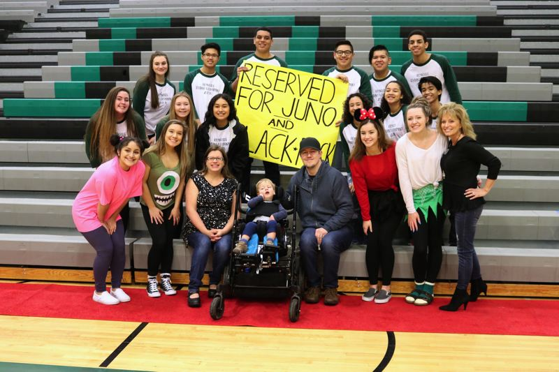 CONTIRBUTED PHOTO: REYNOLDS SCHOOL DISTRICT - Juno, his dad, Jason, and mom, Dawn, gather with Reynolds High School student leaders and Sparrow Clubs Laura Queen as students prepare the gym for the Sparrow Club assembly.
