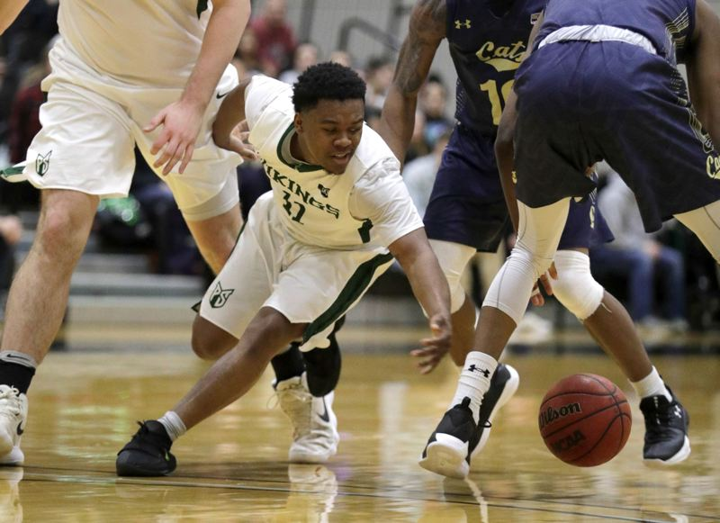 TRIBUNE PHOTO: JONATHAN HOUSE - Deante Strickland of Portland State dives for a loose ball Thursday night in the Vikings' victory over Montana State.