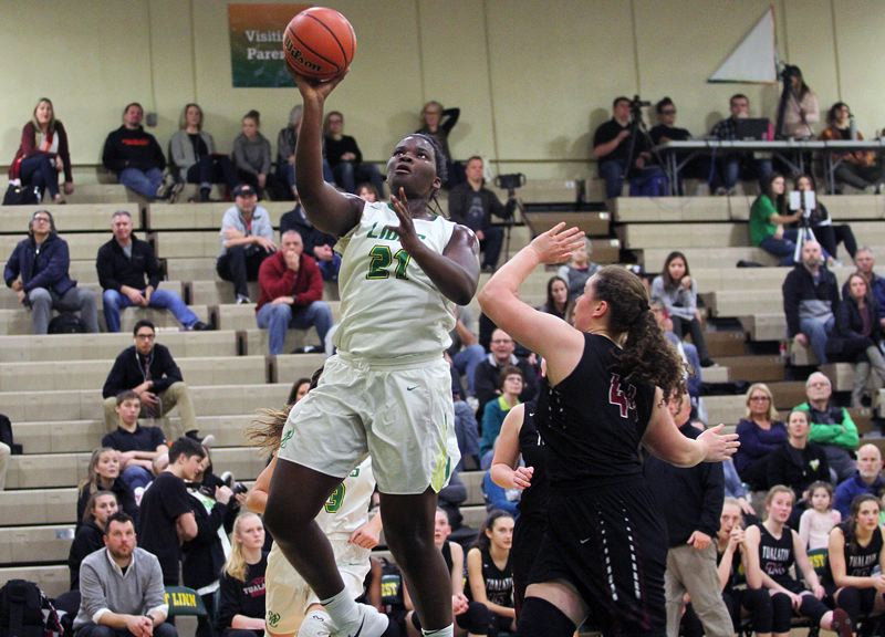 TIDINGS PHOTO: MILES VANCE - West Linn freshman post Aaronette Vonleh goes up for two of her game-high 21 points during the Lions' 57-35 win over Tualatin at West Linn High School on Friday.