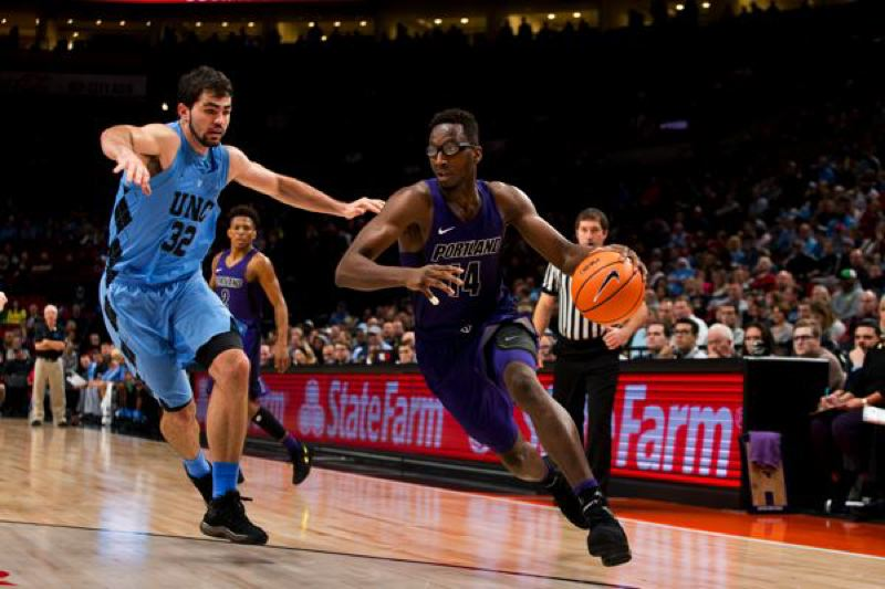 COURTESY: STEVEN GIBBONS/UNIVERSITY OF PORTLAND - Freshman Tahirou Diabate (right), a 6-9 freshman forward who played high school basketball in Japan, drives to the basket for the Portland Pilots.