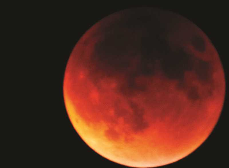 LON AUSTIN/CENTRAL OREGONIAN  - Above is a photo of the last full lunar eclipse that occurred on Sept. 28, 2015. However, the eclipse this Wednesday will be a super blue blood moon eclipse, which hasn't happened in 150 years.