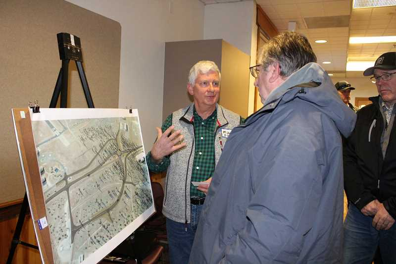 HOLLY SCHOLZ - ODOT Project Leader Mike Darling explains the roundabout plan to a visitor during the roundabout open house Thursday. ODOT, Crook County and the City of Prineville hosted the event.