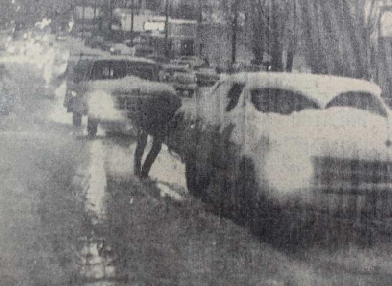 CENTRAL OREGONIAN FILE PHOTO   - WINTER NIGHT SCENE last Friday night after sudden fall of snow left North Main at 10th a sea of glass. Motorists were stalled back to Sixth Street bridge. City sanding crews didn't make scene fast enough to prevent traffic tangle. (Feb. 1, 1968)
