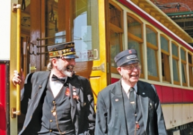 by: Peter Korn, Motorman Neal Berlin (left) and conductor Bill Binns keep passengers laughing, and rolling their eyes, on the vintage trolley between downtown and the Lloyd Center on Sundays.