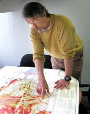 by: CALVIN HALL James Roddey, director of communications for the American Red Cross' Oregon chapter, reviews a color-coded map of the Portland-metro area that shows its geological risks during an earthquake.