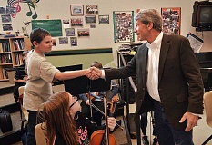by: TIDINGS PHOTO: VERN UYETAKE - U.S. Congressman Kurt Schrader shakes hands with Rosemont Ridge Middle School student Alex Wilson.