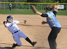 by: MATTHEW SHERMAN - Lake Oswego's Samantha Silva slides into home plate in the second inning in Monday's Civil War loss to Lakeridge at Lake Oswego Jr. High.