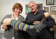 by: TIDINGS PHOTOS: VERN UYETAKE - Kris Dahlgren Kachirisky and her father, Dahlgren founder Ray Dahlgren, show examples of their socks, recently voted best sock in America.