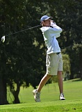 by: VERN UYETAKE - Lake Oswego's Alex Wrenn eyes a shot during his round at Oswego Lake Country Club on Monday. Wrenn shot a 68 to earn medalist honors at the event.