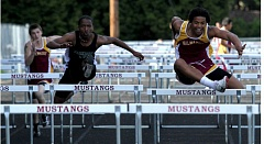 by: JONATHAN HOUSE - Milwaukie senior Kendrick Bourne (right) heads for first place in the high hurdles in last weeks 95-49 dual win over Parkrose.
