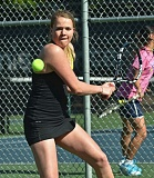 by: VERN UYETAKE - Ella Riddle readies to hit a backhand during last week's district tournament.