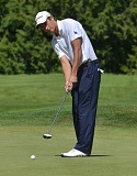 by: VERN UYETAKE - Lake Oswego's Clayton Madey hits a putt during his second-day round of 67 which helped him rally for the district title.