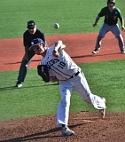 by: VERN UYETAKE - Lake Oswego's Jordan Horak makes a pitch in the Lakers' 7-1 victory over West Linn on Monday.