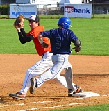 by: JOHN BREWINGTON - Scappoose's Steven Johnson hauls in an out, just ahead of Banks Graysen Partain reaching base.