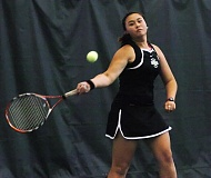 by: DAN BROOD - DISTRICT CHAMP -- Sherwood senior Nancy Nguyen, shown here in quarterfinal play, teamed with senior Courtney Mostul to win the NWOC district doubles championship for the second straight year.