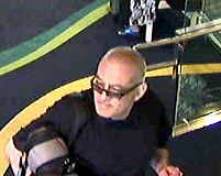 by: COURTESY OF CRIME STOPPERS - A tubby, bald white man is suspected in two thefts from Portland-area hospitals on May 14. Crime Stoppers is offering a $1,000 reward for information leading to the thief's arrest.