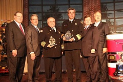 by: SUBMITTED - Chief Mike Duyck, third from right, and his team accept an award on behalf of firefighters and staff who spent hours conducting research on a joint project with the Office of the Oregon Fire Marshal and the Governor's Fire Service Policy Council.