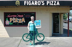 Photo Credit: ESTACADA NEWS PHOTO: ISABEL GAUTSCHI - Chamber President and Figaro's Pizza owner Tamara Pugh shows off one of Estacadas newest bike racks.