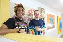 Photo Credit: LINDSAY KEEFER - Lionel Parra (left), of Woodburn, and Doug Sundman, of Lake Oswego, stand in the Guggle Gallery on Young Street in Woodburn. The show Altered Universe opens Saturday night and runs through Aug. 17.