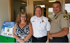 Photo Credit: SUBMITTED PHOTO - From left, Cindy Brockett of BestCare Prevention, CRR Fire Chief Rich Hoffman, and Sheriff Jim Adkins partnered up to install a 24-hour medication collection box in the lobby of the Ranch fire station.