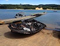 Photo Credit: WASHINGON COUNTY SHERIFF'S OFFICE - A boat was destroyed and  dock was damaged by a Sunday morning fire at Hagg Lake.