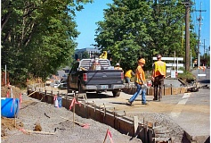 Photo Credit: RITA A. LEONARD - An ODOT crew installed ADA-accessible sidewalk ramps, and realigned the Milwaukie Avenue exit ramp and the curb at the top of the ramp from McLoughlin Boulevard southbound, in a recent three-week state-funded project.