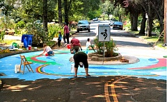 Photo Credit: DAVID F. ASHTON - Volunteers touch up the Bybee Circle on repainting day.