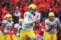 Photo Credit: TRIBUNE FILE PHOTO: JAIME VALDEZ - Oregon quarterback Marcus Mariota is heeding the advice of fellow Hawaiian football player Manti Teo as the Ducks embark on their 2014 journey.
