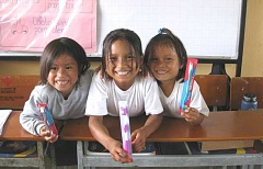 Photo Credit: COURTESY OF GREG WILLIAMS - A GOOD DAY'S WORK  - Ecuadorian village children happily show off their new toothbrushes that hopefully wil last them a long time.