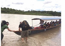 Photo Credit: COURTESY OF GREG WILLIAMS - GETTING AROUND NATIVE-STYLE - The Wide Open Humanitarian team gets ready to push a long boat from the bank of the Misa River in Ecuador to head to a new village.
