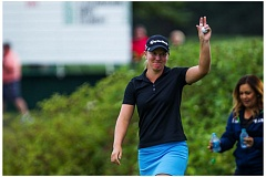 Photo Credit: COURTESY OF DAVID BLAIR - Austin Ernst ackowledges the crowd after winning the LPGA Portland Classic in a playoff with I.K. Kim at Columbia Edgewater Country Club.