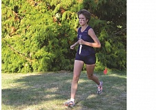 Photo Credit: SPOKESMAN FILE PHOTO - Chloe Thompson running during a meet last year.