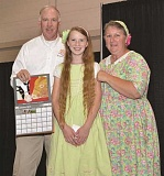 Photo Credit: SUBMITTED PHOTO - Homeschooled seventh-grader Faith Hans, center, poses with her mother, Debbie Hans, and Greg Thompson, master of ceremonies for the Oregon State Fair event.