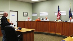Photo Credit: COURTNEY VAUGHN - John Harper addresses the Scappoose City Council during a meeting Tuesday, Sept. 2. Harper advised the councilors about taxing marijuana, if it becomes legal to sell in city limits.